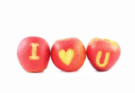 Fresh red apple with I love you shaped cut-out on white background photo