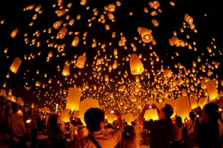 CHIANGMAI THAILAND OCTOBER 28 : people lift the sky landterns in Loy Krathong and Yi Peng Festival on October 28, 2011 Chiangmai, Thailand