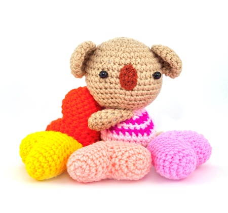 knitting wool bear hold and surround by wool heart Stock Photo