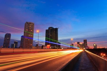 Night street view of Bangkok city on Taksin Bridge Stock Photo
