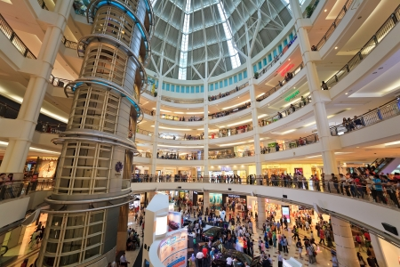 KUALA LUMPUR, MALAYSIA - APRIL 13 : full of crowd in Suria Shopping Mall. Suria KLCC is the luxury shopping locate at lower floor of Petronas Towers. On April 13, 2013, Kuala Lumpur, Malaysia