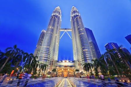 KUALA LUMPUR, MALAYSIA - APRIL 13: Nightscape of Petronas Twin Towers on April 13, 2013 in Kuala Lumpur Malaysia. Petronas Twin Towers were the tallest buildings (452m)  in the world during 1998-2004. Editorial