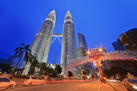 KUALA LUMPUR, MALAYSIA - APRIL 13: Nightscape of Petronas Twin Towers on April 13, 2013 in Kuala Lumpur Malaysia. Petronas Twin Towers were the tallest buildings (452m)  in the world during 1998-2004. Stock Photo - 19169322