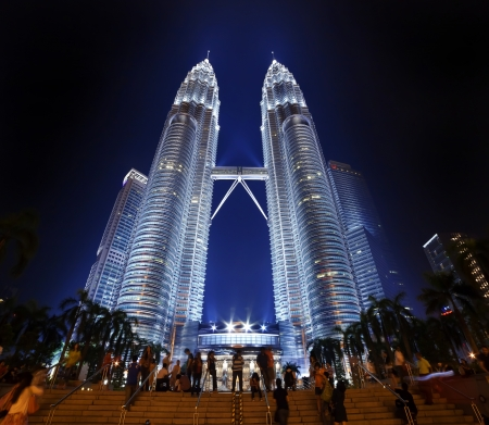 KUALA LUMPUR, MALAYSIA - APRIL 13: Nightscape of Petronas Twin Towers on April 13, 2013 in Kuala Lumpur Malaysia. Petronas Twin Towers were the tallest buildings (452m)  in the world during 1998-2004. Stock Photo - 19169313