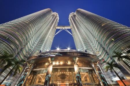 KUALA LUMPUR, MALAYSIA - APRIL 13: Nightscape of Petronas Twin Towers on April 13, 2013 in Kuala Lumpur Malaysia. Petronas Twin Towers were the tallest buildings (452m)  in the world during 1998-2004. Stock Photo - 19256989