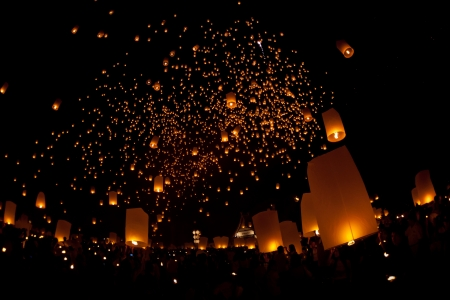 people lift the sky landterns in Loy Krathong and Yi Peng Festival , Chiangmai, Thailand