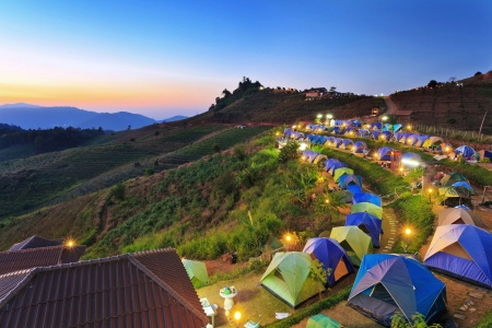 distant: camping tent at dawn on the mountain in Chiangmai Thailand