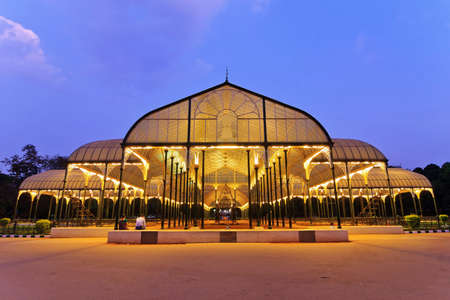 BANGALORE,INDIA FEBRUARY 19 : The Glass House of Lal Bagh Botanical Gardens glowing at night on February 12,2011. It has many collection of tropical plants, has an aquarium and a lake, and is one of the main tourist attractions in Bangalore, India Editorial