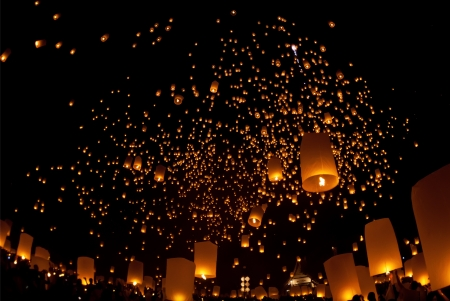 people lift the sky landterns in Loi Krathong and Yi Peng Festival , Chiangmai, Thailand