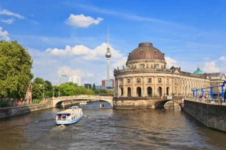Bode Museum on museum island with Spree river and Alexanderplatz TV tower, Berlin, Germany