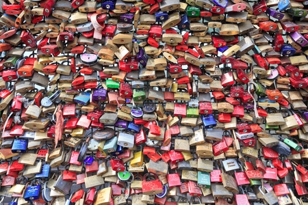 COLOGNE, GERMANY - JUNE 15: lockers at the Hohenzollern bridge symbolize forever love on JUNE 15,2013, Cologne, Germany. The bridge was constructed between 1907 and 1911 after the old bridge, the Cathedral Bridge was demolished