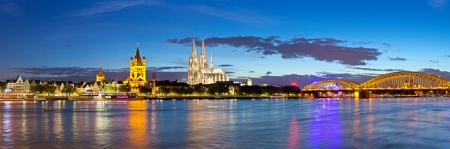panorama of Cologne city and Rhine river at night, Germany Stock Photo