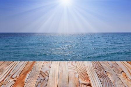 wooden dock: wooden pier over ocean and sunshine sky