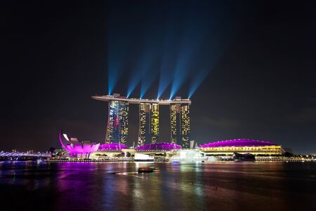 SINGAPORE - APRIL 15   Laser show of Singapore Marina Bay Sand on April 15, 2013, Singapore  Marina Bay Sands is billed as the world Editorial