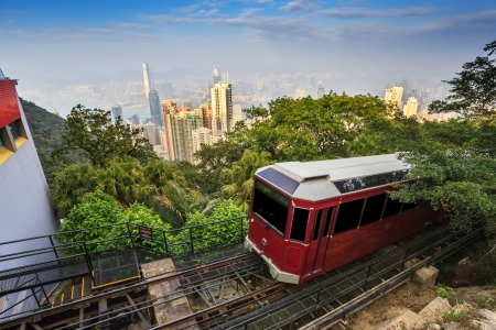 The Victoria Peak Tram and Hong Kong city skyline Stock Photo