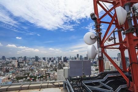 Telecommunication tower and urban city skyline