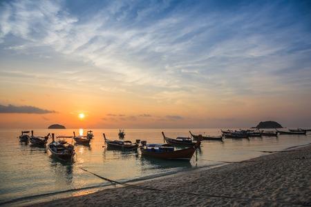 longtail: Sunrise and longtail boat of Koh Lipe, Thailand Stock Photo