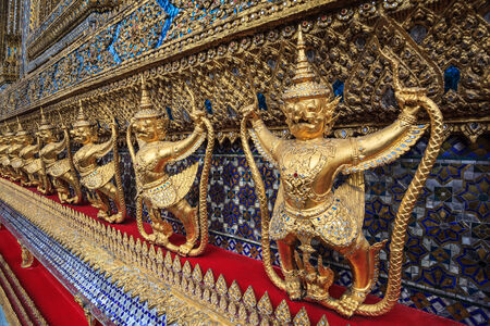 golden garuda statue at Wat Phra Kaew, Bangkok, Thailand photo