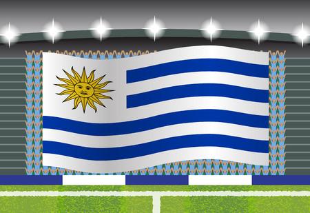football fan: Uruguay football fan cheering on stadium with flag