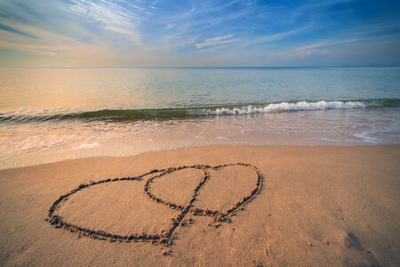 heart in sand: Love heart on the beach in vintage style Stock Photo