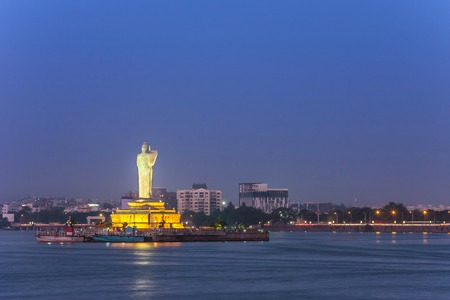 monolithic statue of the Gautam Buddha in the middle of the lake Hussain Sagar , India photo