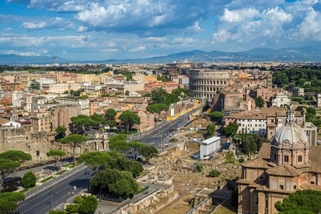 colosseum: Rome skyline and Colosseum - Italy Stock Photo