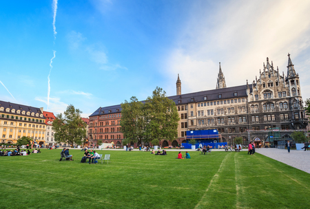 townhall: MUNICH, GERMANY - JUNE 7 : People relaxing in the garden behind Marienplatz town hall on June 7,2013 in Munich Germany.