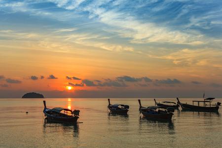 koh: sunrise at Koh Lipe island and Longtail boat - Thailand Stock Photo