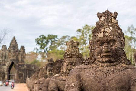 siem reap: Statue at gate of Angkor Thom, Siem Reap, Cambodia Stock Photo