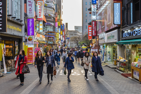 MYEONG-DONG, SEOUL, KOREA: APRIL 1,2016: People shopping and walking in Myeongdong street market, Seoul, South Korea