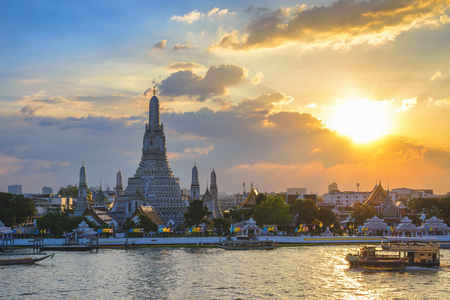 Bangkok Thailand, sunset city skyline at Wat Arun temple and Chao Phraya River