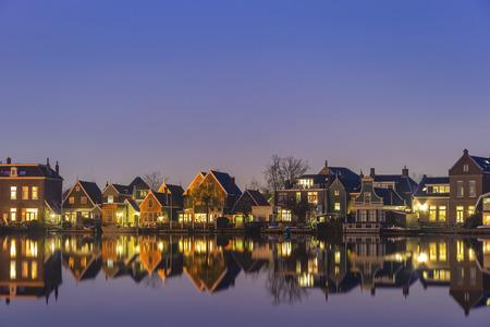 Amsterdam Netherlands, Night skyline of Dutch traditional house at Zaanse Schans Village Фото со стока - 121079951