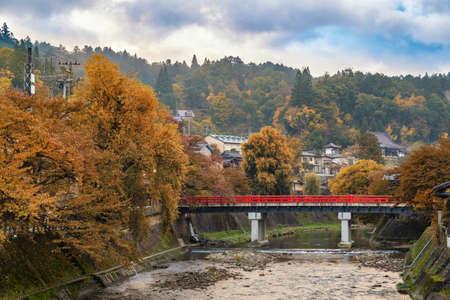 Takayama Japan, autumn landscape foliage at red Nakabashi bridge and Miyakawa river