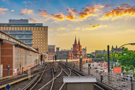 Berlin Germany, sunset city skyline at Oberbaum Bridge and Berlin Metro