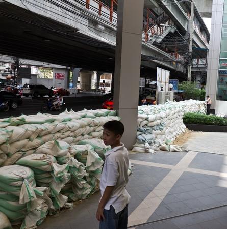 BANGKOK - NOV 10: worst flood disasters in 50 years hits Bangkok streets. Bangkok flooding, 10 November 2011. unidentified people and sandbags