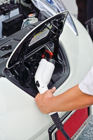 propellant: the man prepare to plug-in refill electric power to car