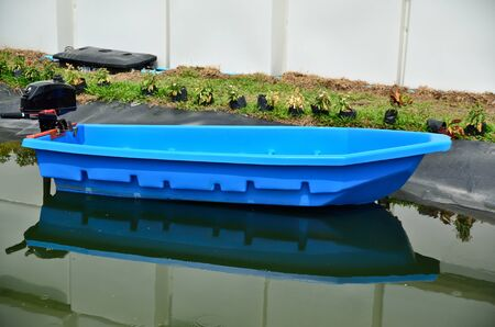 fiberglass: the blue fiberglass boat test Stock Photo