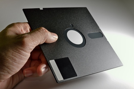 hand holding old format Diskette of 5,25 inches
