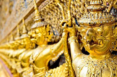 Golden Garuda statue in Wat Phra Kaew Grand Palace of Thailand photo