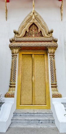 wood carving door: the golden windows temple in Bangkok, Thailand Editorial
