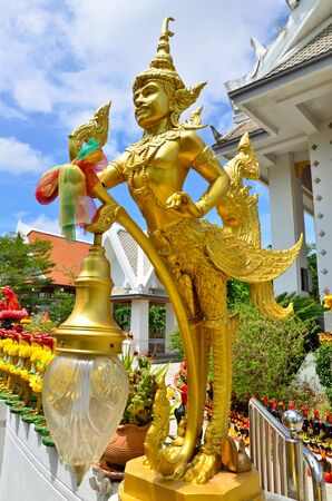 Golden Angle at Thai temple and blue sky , Bangkok, Thailand