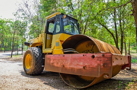 Heavy tandem Vibration roller in forest Stock Photo