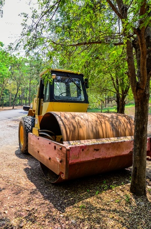 vibroroller: Heavy tandem Vibration roller in forest Stock Photo