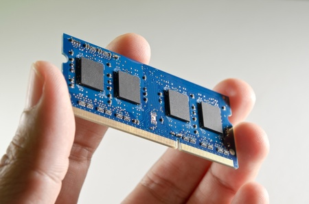Hand holding DDR memory from notebook Technical support concept