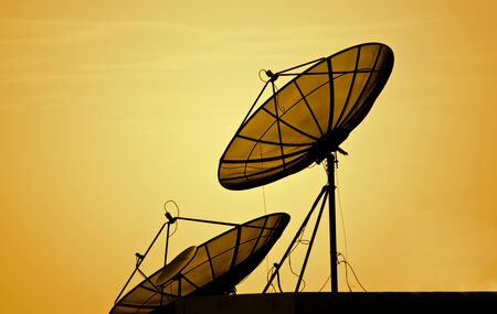 satellite in space: satellite dishes over sunset, silhuette style Stock Photo