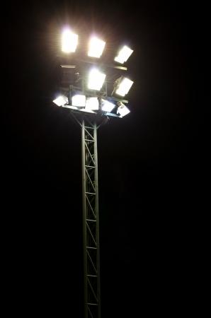 Stadium lights on a sports field at night Stok Fotoğraf