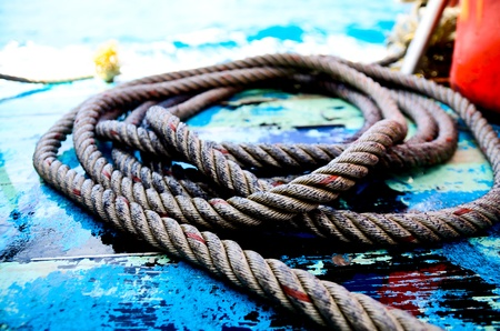 Ropes on a sail boat wet floor Stock Photo