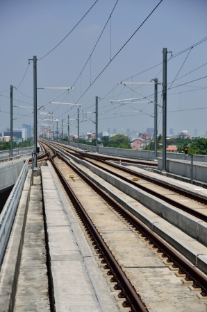 Sky train railway in Bangkok with business building photo