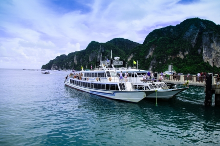 phi phi island: the ferry boat parking at Phi Phi island gulf, thailand Editorial