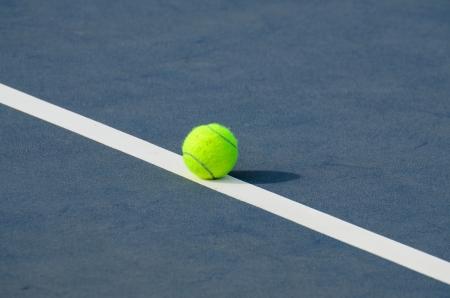 Tennis Balls shot on a outdoor tennis court on the line